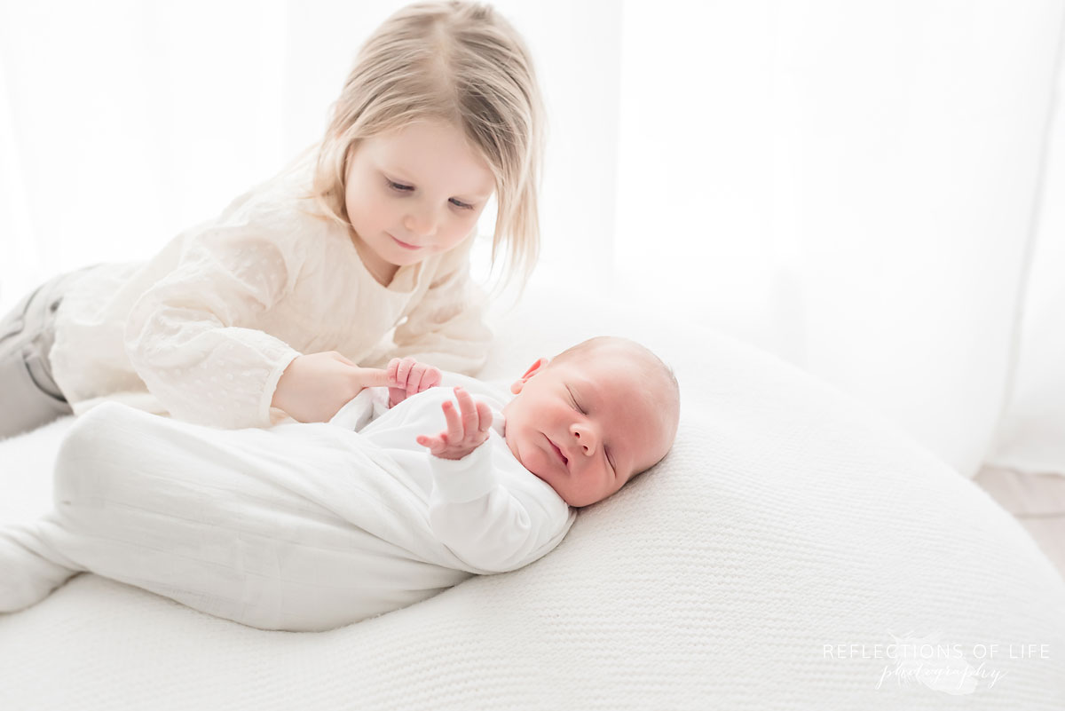 little girl with new sibling.jpg