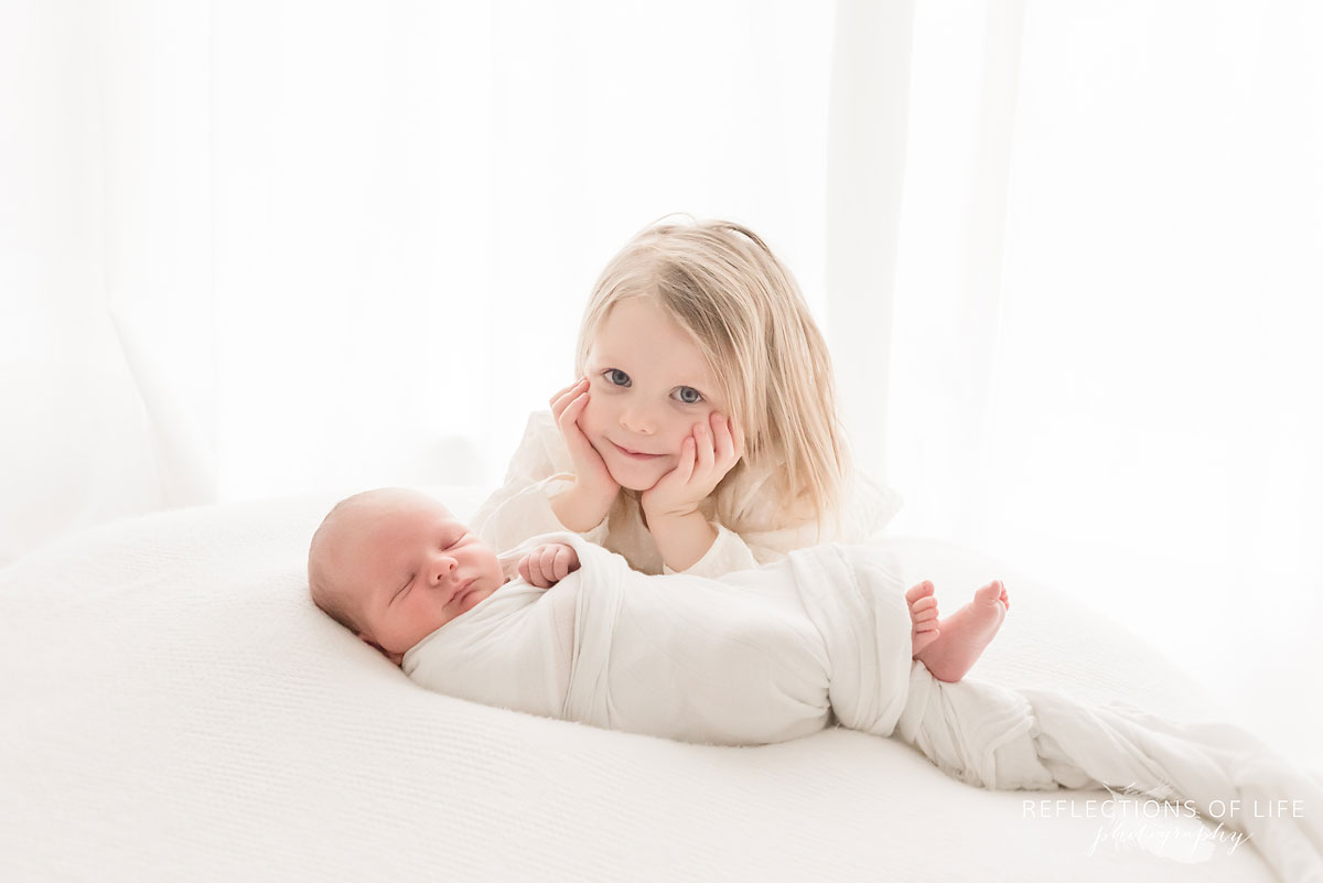 girl smiling with newborn.jpg