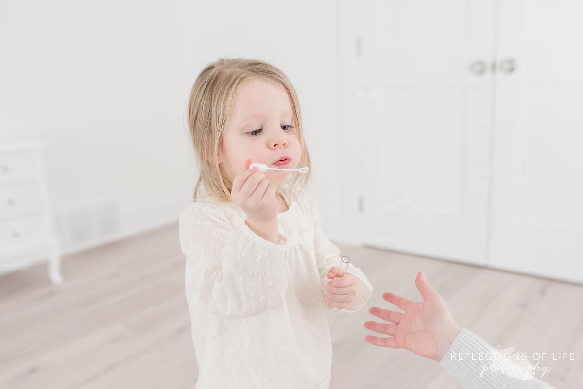 girl blowing bubbles.jpg