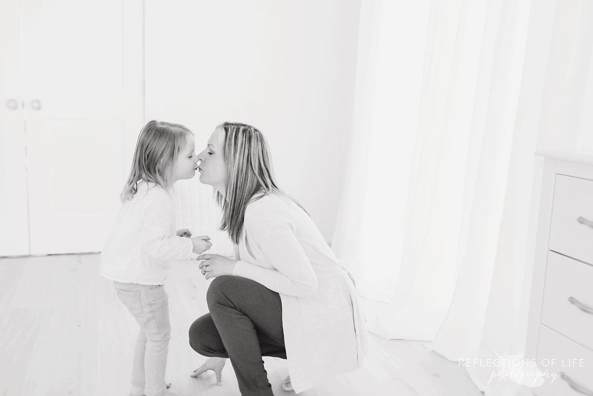 mother kissing daughter.jpg