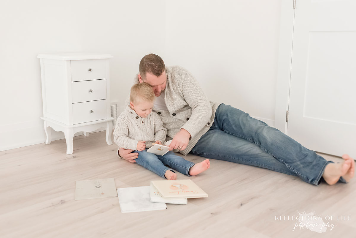 Dad and his son reading a book in natural light photo studio.jpg