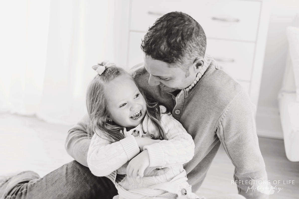Father and daughter hugging black and white
