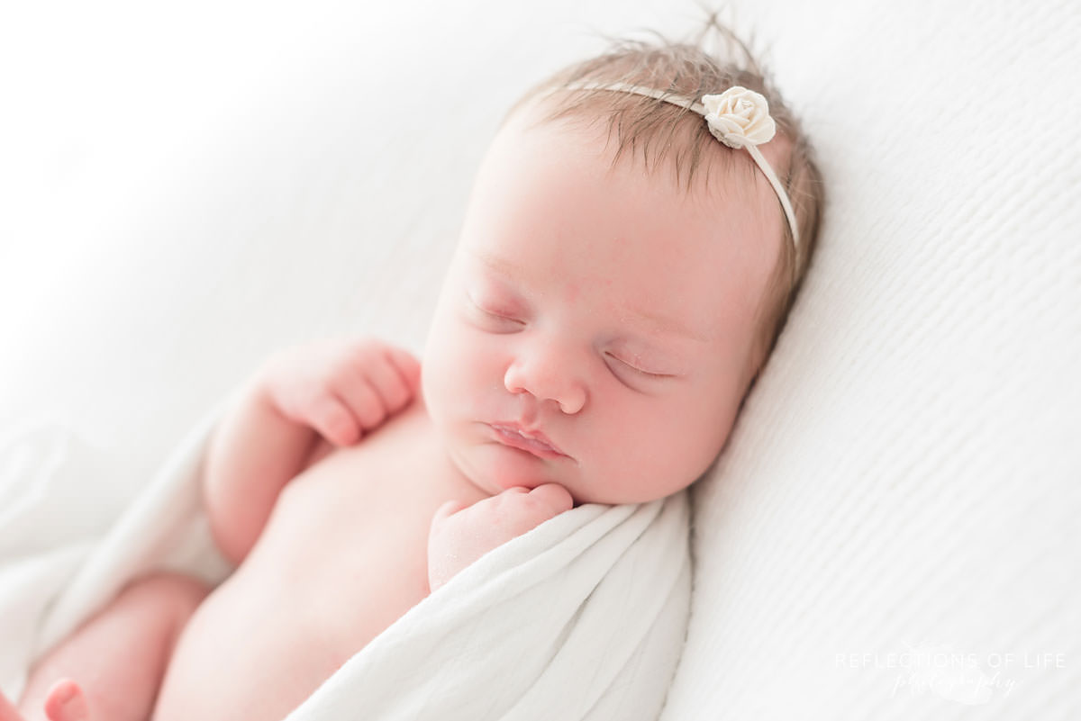 Close up of cute baby in natural light studio