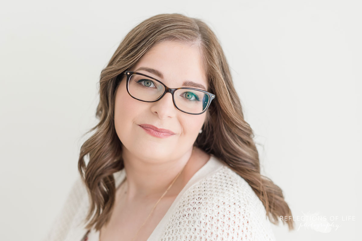 beautiful woman with glasses looks at the camera