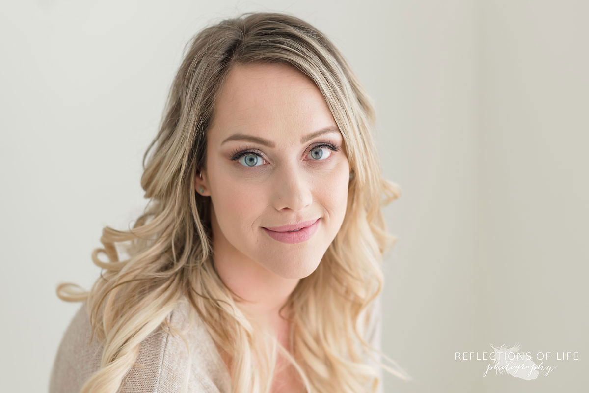 Maxine McLellan gorgeous headshot of young blond mama with long loose curls