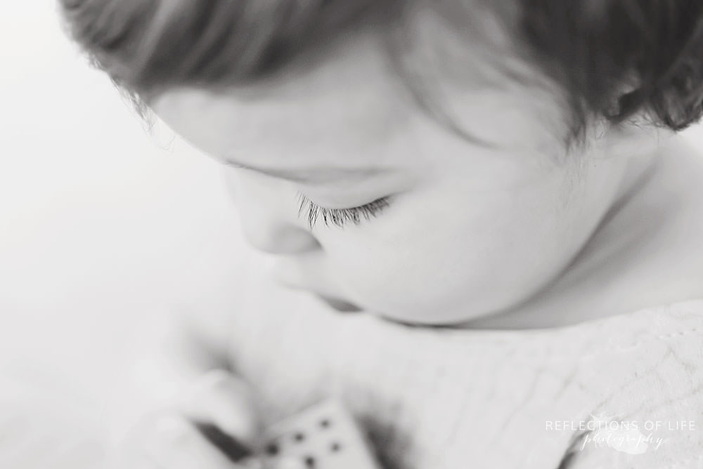 Close up of toddlers eyelashes in black and white