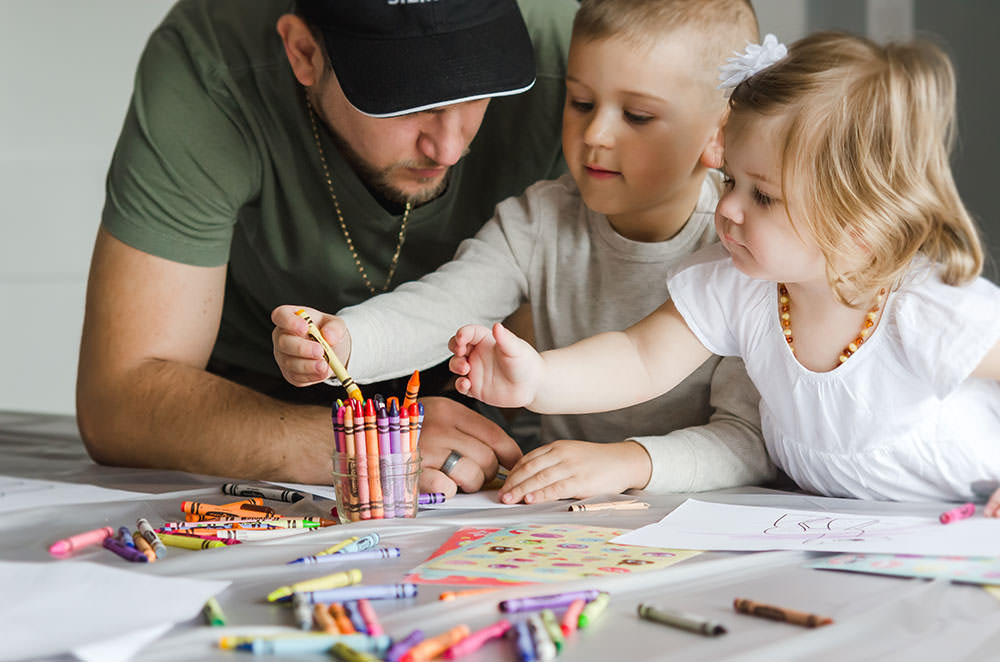 cute kids colour with their dad