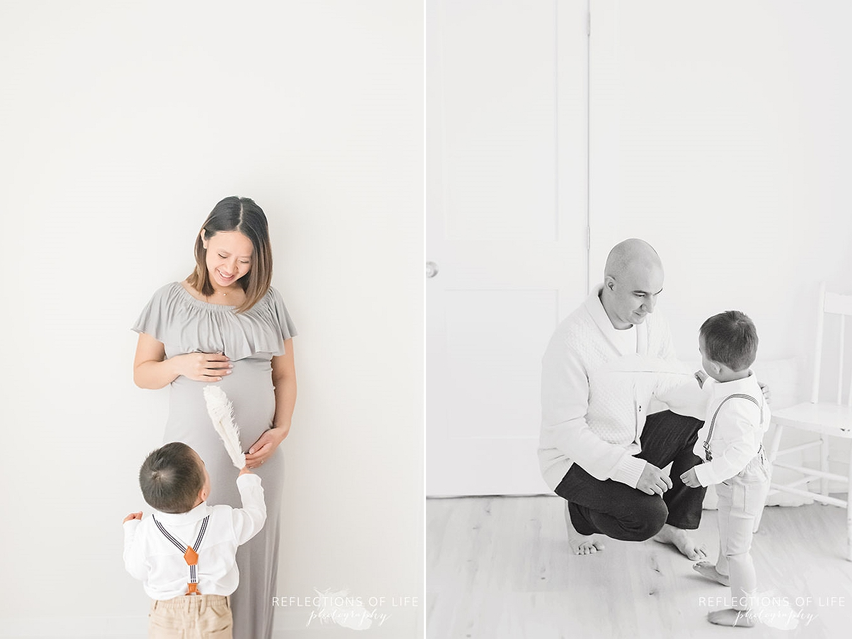 who photos of little boy ticking his mothers belly with a feather and showing his dad in black and white