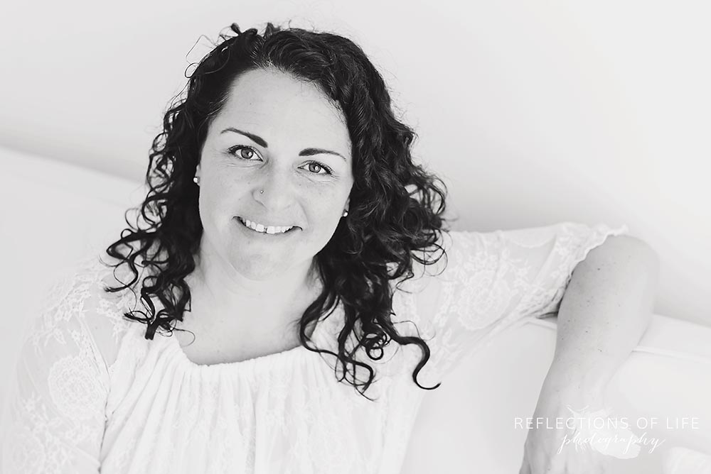 beautiful new mom in natural light studio in black and white