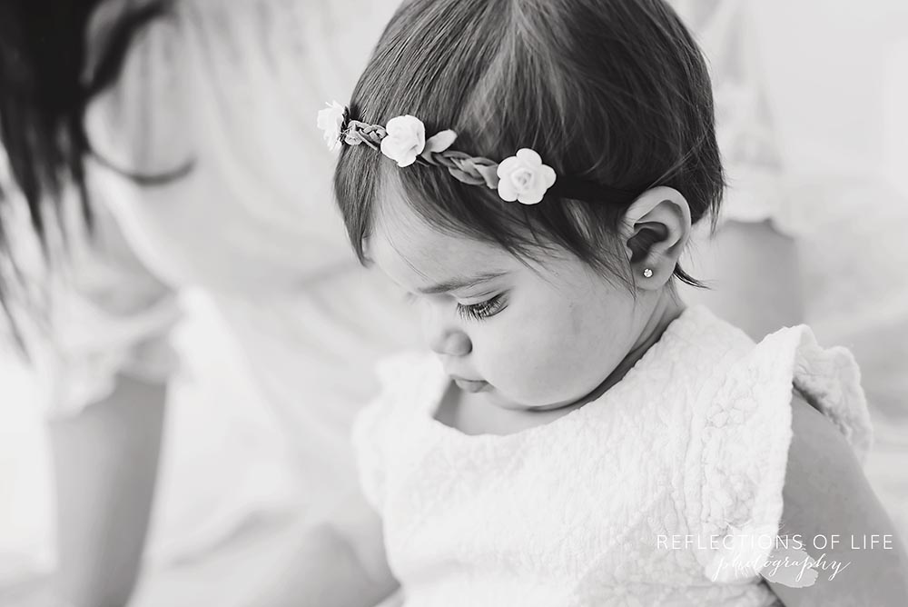 profile of baby's flower head band in black and white`