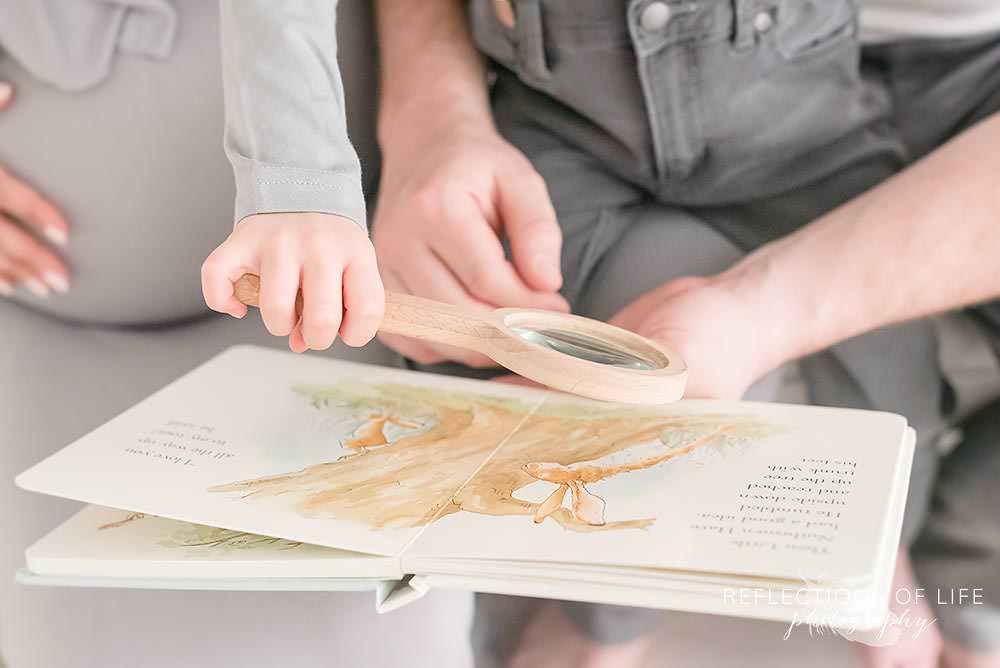 Close up of a book while a family reads Grimsby Family Photographer
