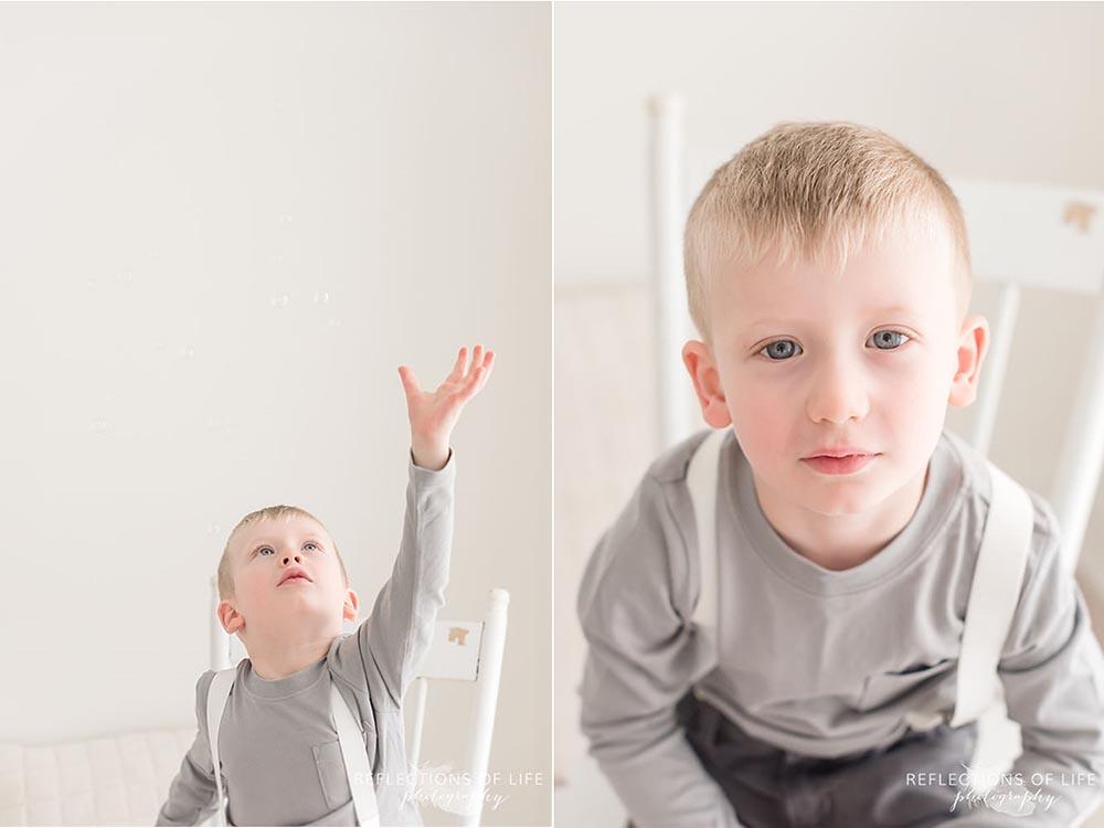 Little boy blowing bubbles Niagara family photography