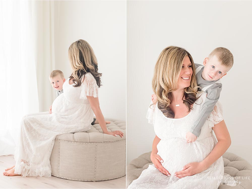 Little boy peeks out from behind pregnant mom Niagara maternity and family photos