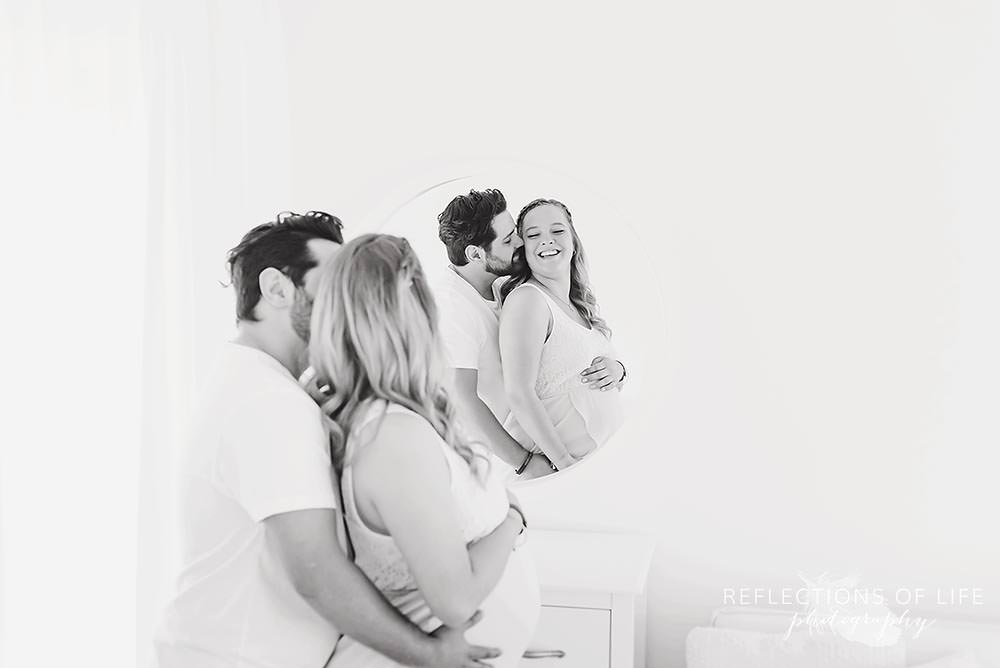 couples maternity photography laughing in mirror