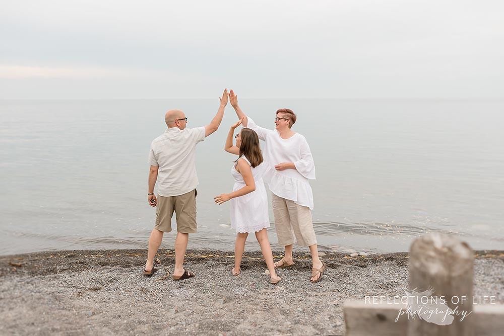 Candid family photos at a beach in Grimsby Ontario