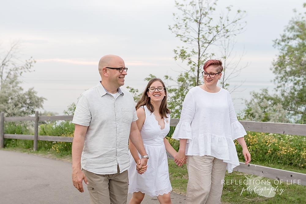 Family walking up the road near the beach in Niagara Region of Ontario