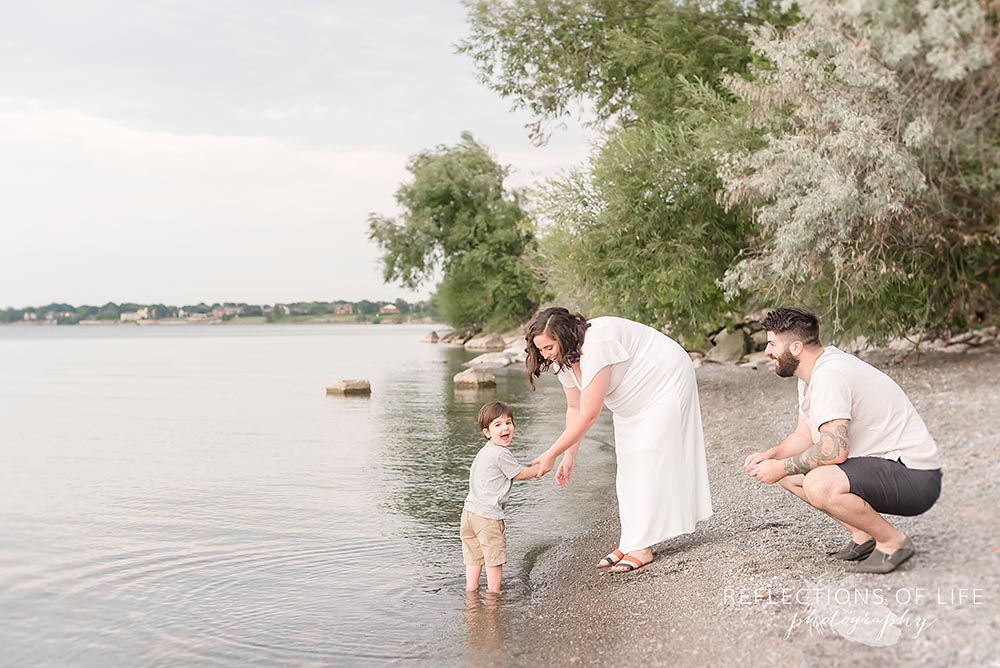 Family plays by the water at Casablanca Beach Grimsby Ontraio.jpg