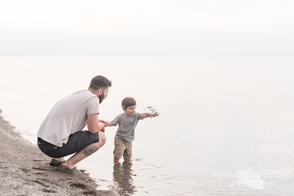 Dad and son play at the beach in Niagara Ontario.jpg