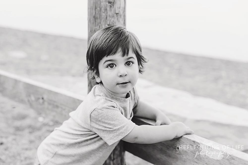 Little boy looking serious at the camera in Niagara Ontario .jpg