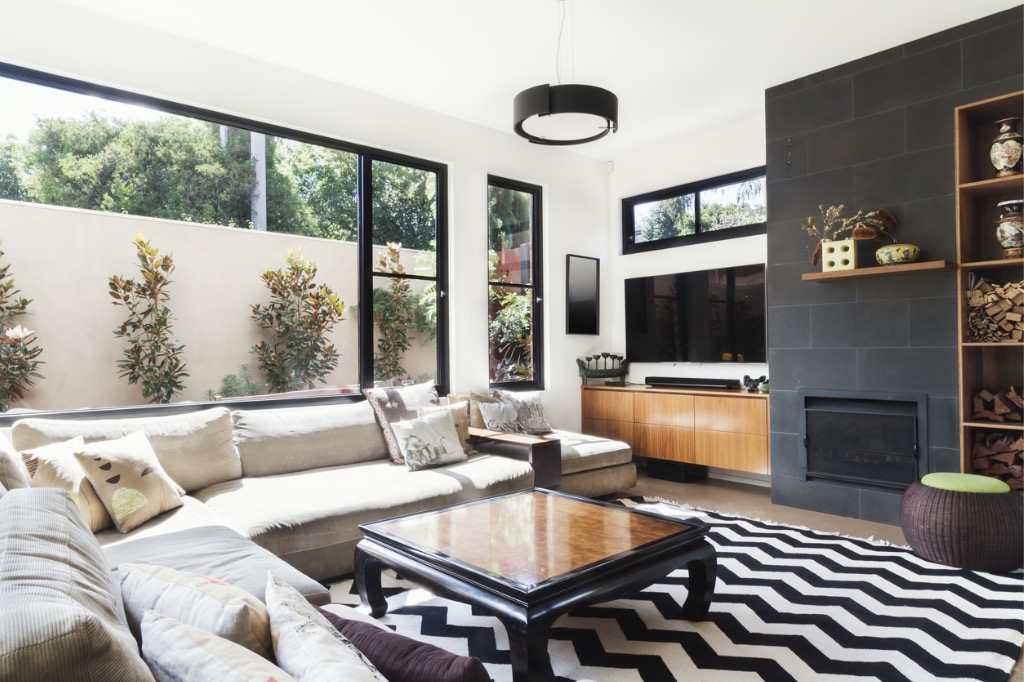 monochrome-living-room-with-wood-and-grey-tiling-accents-picture-id876786836.jpg