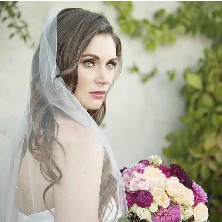 Bride before wedding.Pink lipstick,loose waves