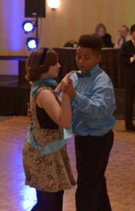 RACHEL AND JORDAN DANCING AT THE COLORS OF THE RAINBOW TEAM MATCH. READ ABOUT HOW DANCING CLASSROOMS IMPACTED HER LIFE.