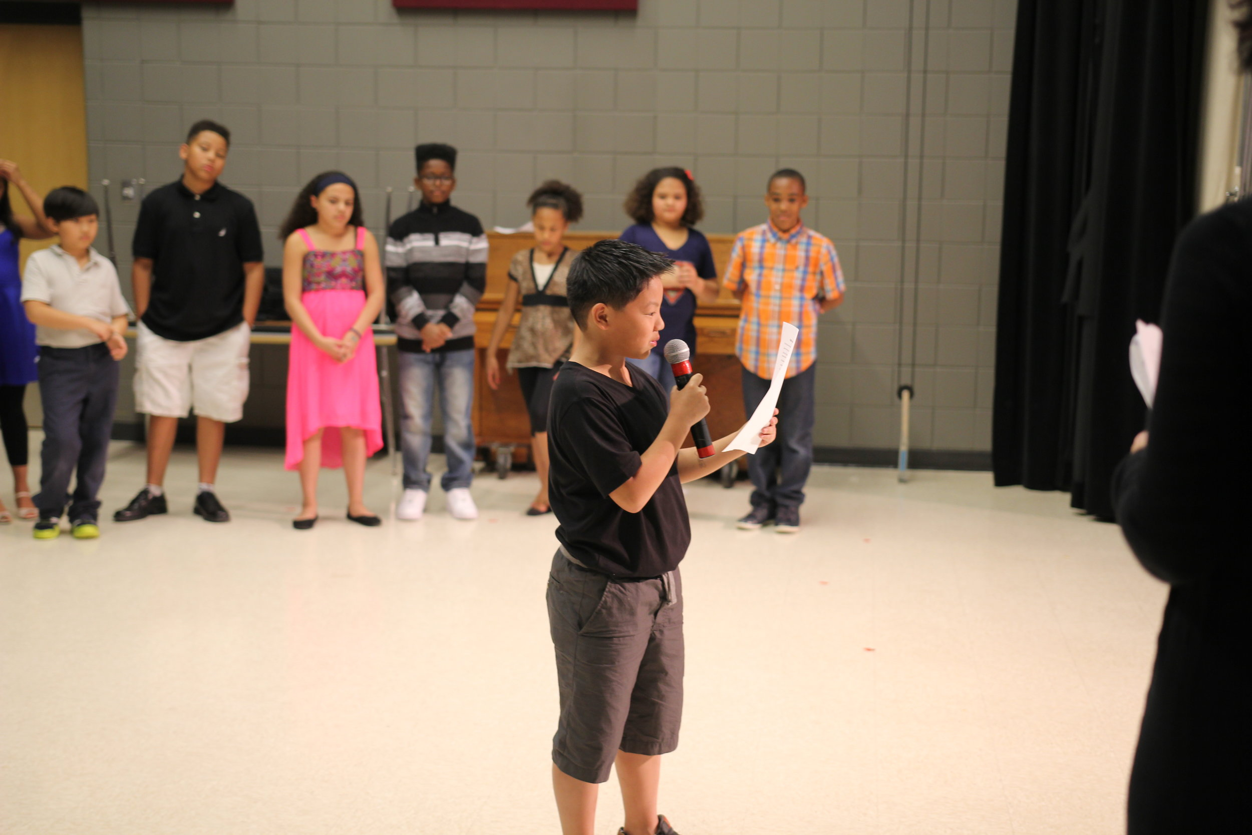 5th Grader at harambee Elementary school's culminating Event