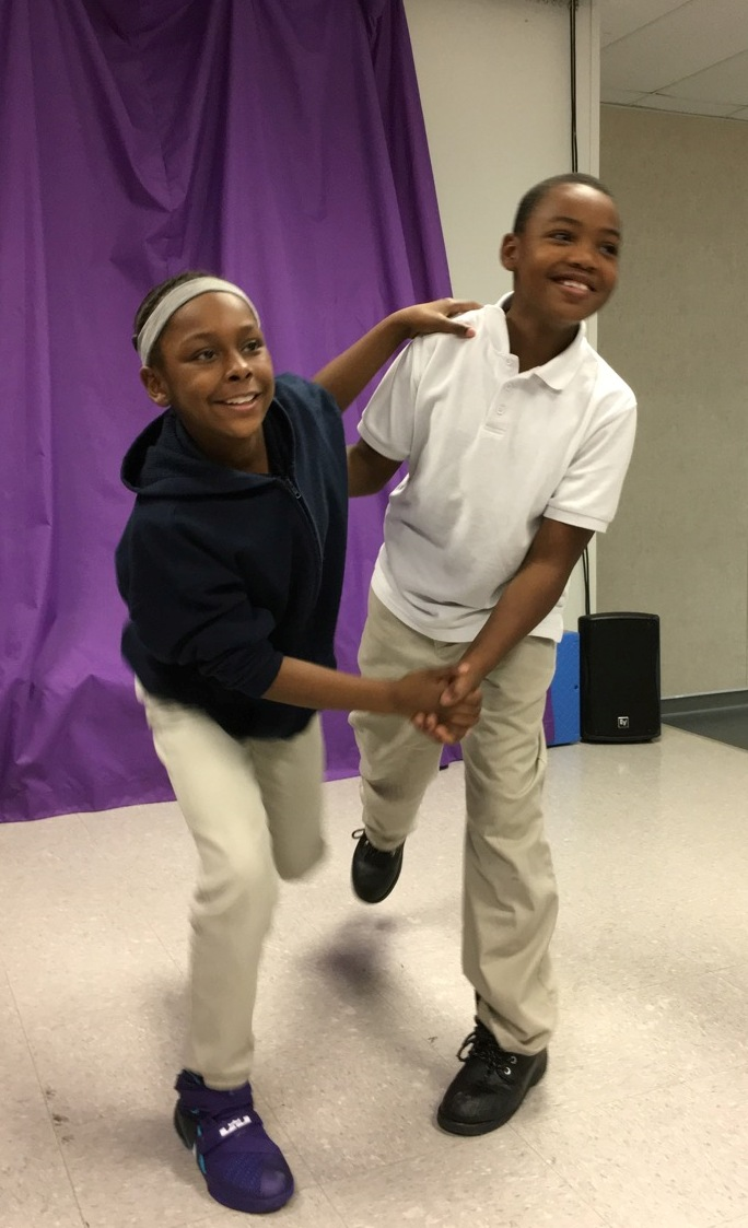 Students at Benjamin Mays I.B. World School happily dancing