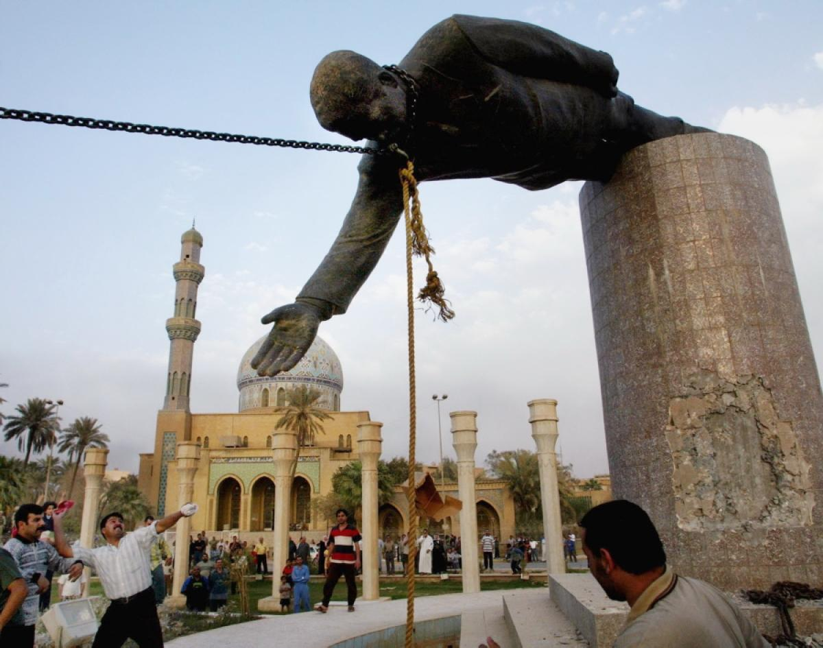 The iconic images of this statue coming down and Iraqi civilians cheering is controversial as it turned out to that it was not a spontaneous moment brought on by Iraqis but rather a managed moment by the U.S. military.
