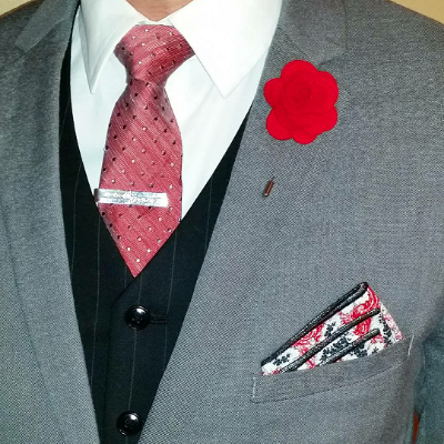 A muted blazer and bold accessories complement the microdot tie and in the red version of this box