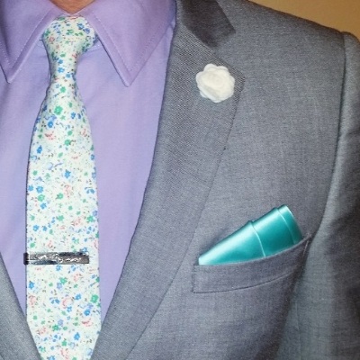 This teal pocket square in a three-stair fold complements my floral tie without being overly matchy