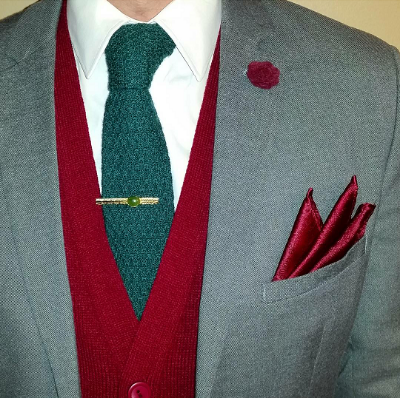 Ike Behar knit tie in evergreen paired with a cranberry cardigan is festive yet professional