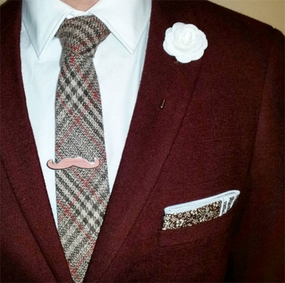 The tie and pocket square from the Movember Box pair well with this burgundy mohair jacket.
