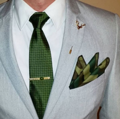 These earthy accessories work well with a neutral white shirt and light gray blazer. A vintage gold tie bar with a jade stone completes the look.