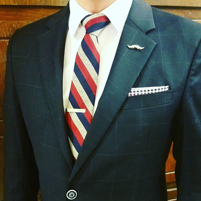 """Far and away the best prize that life has to offer is the chance to work hard at work worth doing."" - Theodore Roosevelt  Happy #GivingTuesday! ---------------------------◇---------------------------- Accessories from November's ""Martin Box"" by @SprezzaBox: ▪Striped necktie: @theknottery ▪Gingham pocket square: @sprezzanyc ▪Mustache lapel pin: @lovelylapels Navy windowpane suit: @the217lincoln Art deco tie clip: #Vintage ---------------------------◇---------------------------- #SprezzaBox #SprezzaNYC #GetDapper #ootdmen #guyswithstyle #menwithstyle #suitup #suitandtie #preppy #gq #gqstyle #gqstylehunt #fashionblogger #styleblogger #styletips #fashionformen #styleformen #mensclothing #fashionpost #currentlywearing #lookoftheday #instafashion #instastyle #dresstoimpress #fashionguru #fashiongram #fashionstyle #thehybridgent"