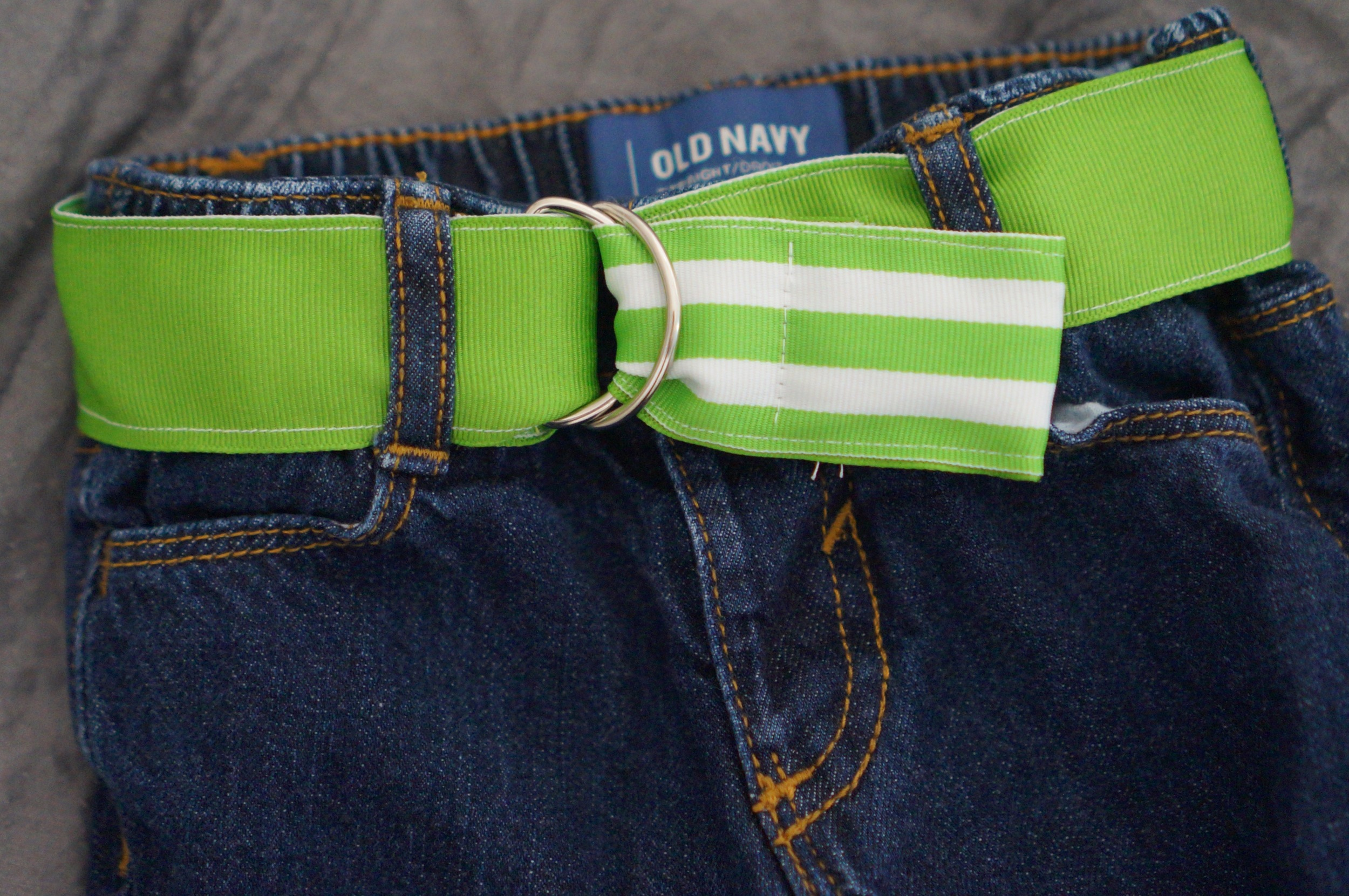 Reversible belt: two pieces of ribbon sandwich a strip of interfacing so that the belt will hold its shape.