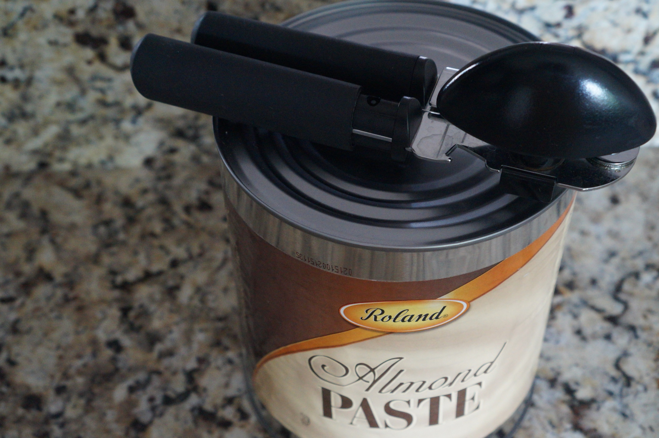 Enormous can of almond paste. Regular-sized can opener for scale.