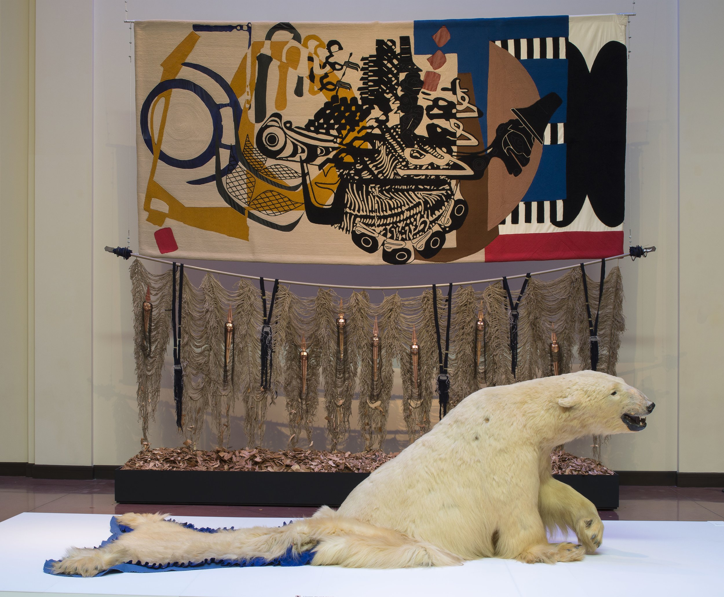 We Dreamt Deaf,  polar bear taxidermy, 2015 |  Axes in Polyrhuthm, When My Drums Come Knocking They Watch , wood, cotton, silk, jute, woodchips, collaboration with Nep Sidhu, 2018.