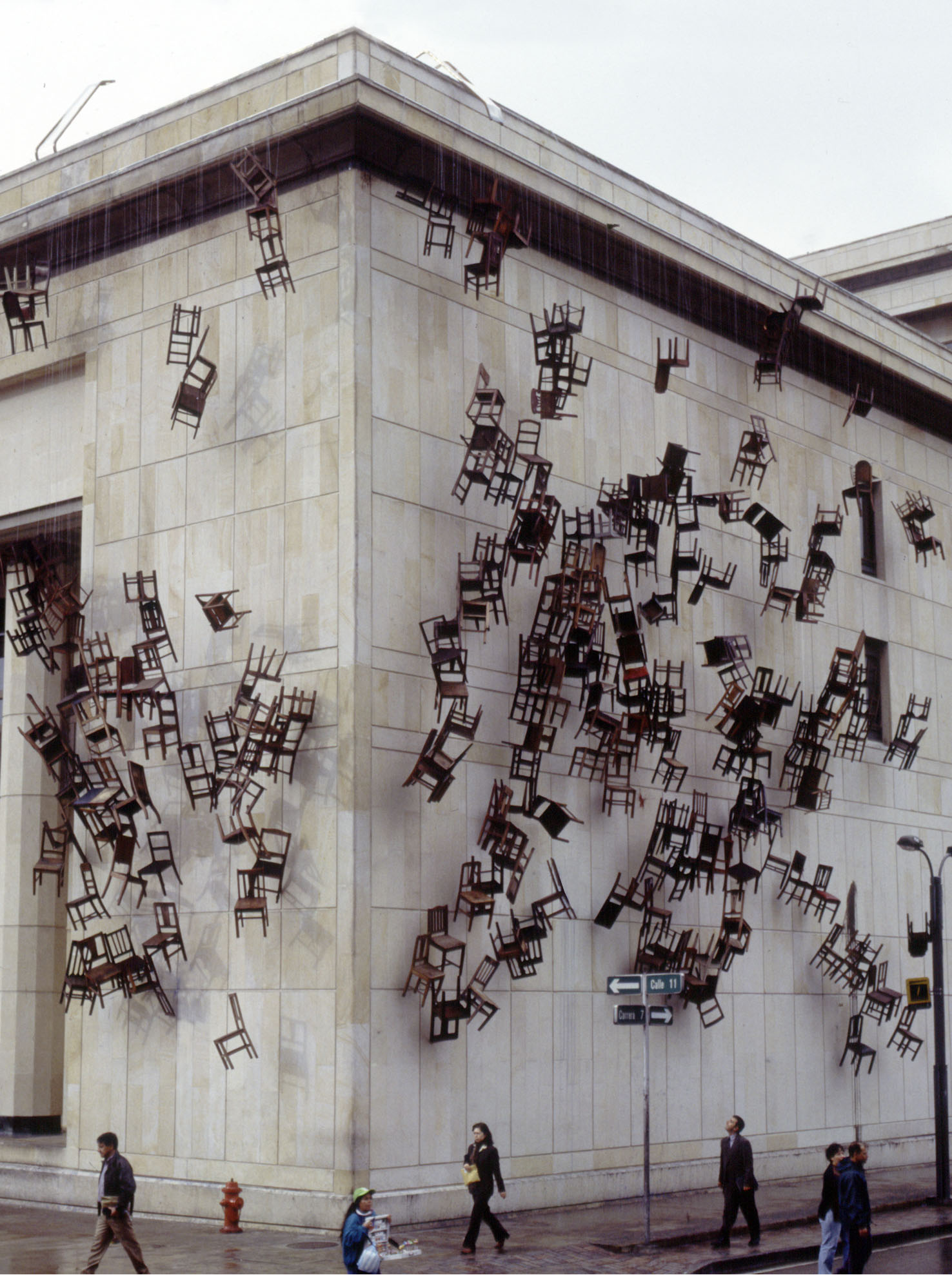 Doris Salcedo,  Noviembre 6 y 7  2002, two hundred and eighty wooden chairs and rope, dimensions variable ephemeral public project, Palace of Justice, Bogotá, 2002. photo: Sergio Clavijo, image courtesy Alexander and Bonin, New York.