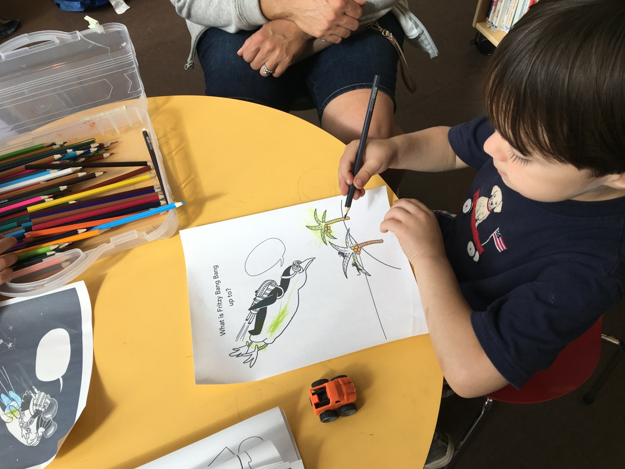 Child coloring in my Fritzy Bang Bang Color and Write Story