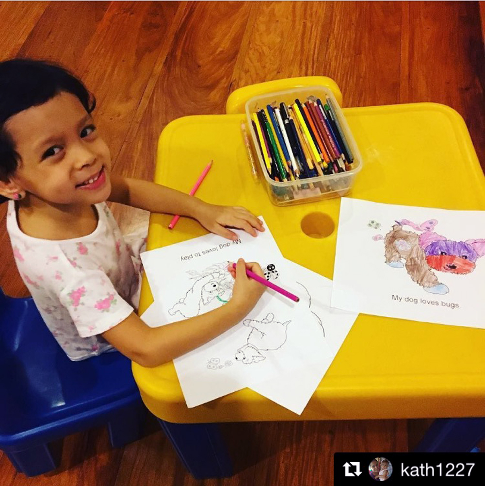 A friend who used to visit my library events before moving away sent me this photo of her daughter with my printable Preschool Color Stories from my website!