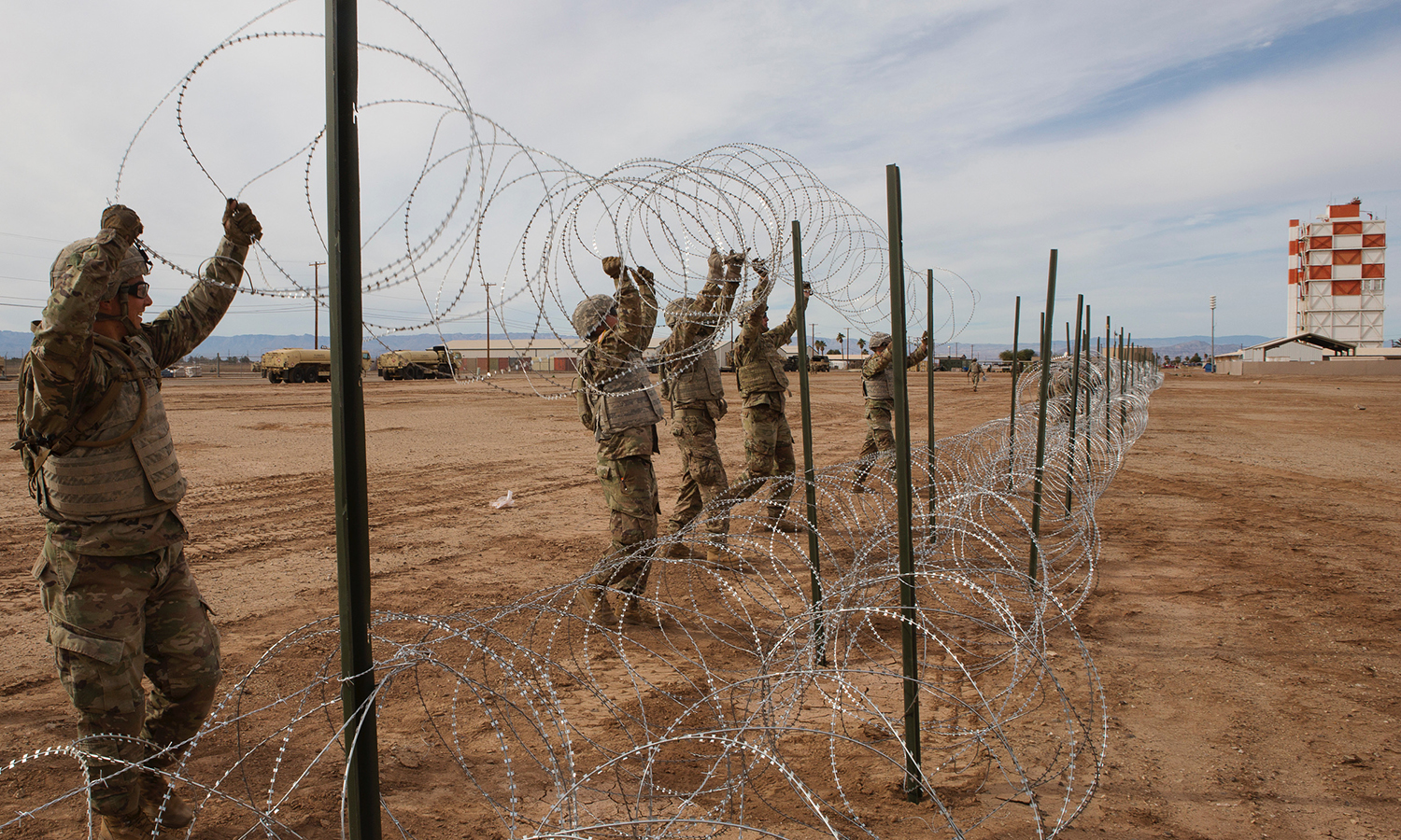 U.S Soldiers with 541st Engineer Company, Special Purpose Marine Air-Ground Task Force 7, position concertina wire on a practice barricade at Naval Air Facility El Centro in California, Dec. 4, 2018. U.S. Northern Command is providing military support to the Department of Homeland Security and U.S. Customs and Border Protection to secure the Southern border of the United States. (photo credit: U.S. Marine Corps photo by Sgt. Asia J. Sorenson).