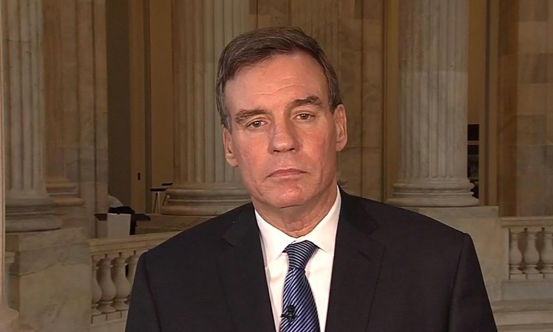 Democratic U.S. Senator Mark Warner of Virginia speaking to reporters on Capitol Hill.