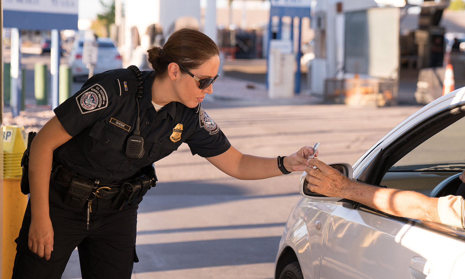 U.S. Customs and Border Protection, Office of Field Operations officer processes passenger; checking identification and vehicle prior to passenger crossing into the United States from Mexico at the San Luis border crossing on Sept. 11, 2017 (photo credit: CBP photo by Scot Osborne).