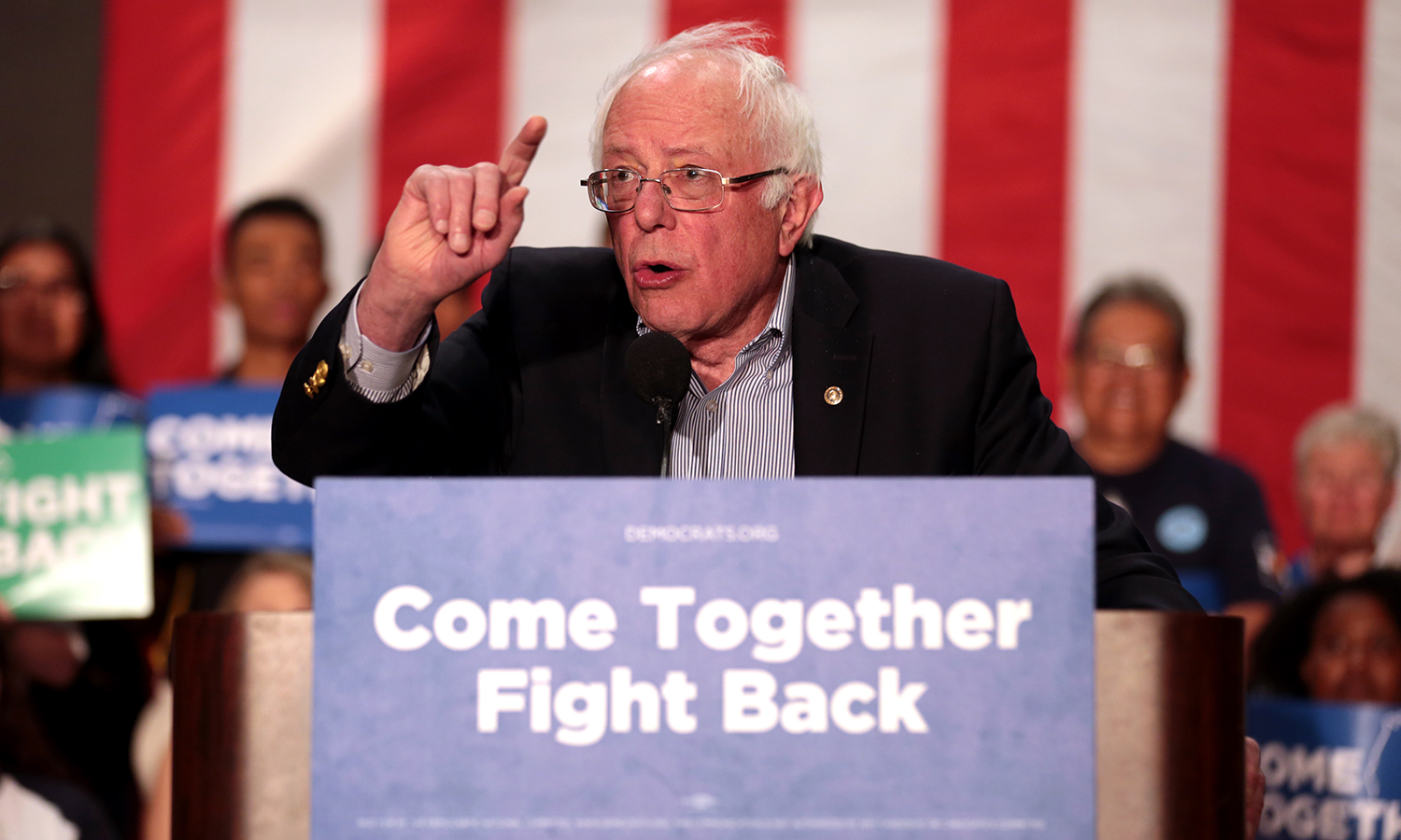 """U.S. Senator Bernie Sanders speaking with supporters at a """"Come Together and Fight Back"""" rally hosted by the Democratic National Committee at the Mesa Amphitheater in Mesa, Arizona on April 21, 2017 (photo credit:  Gage Skidmore )."""