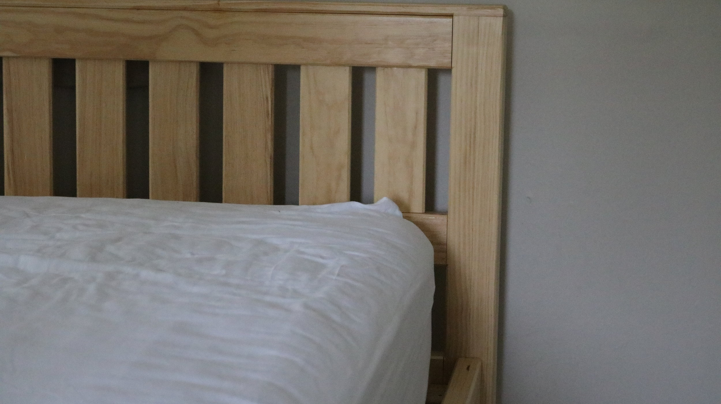 Custom height pine slat bed frame