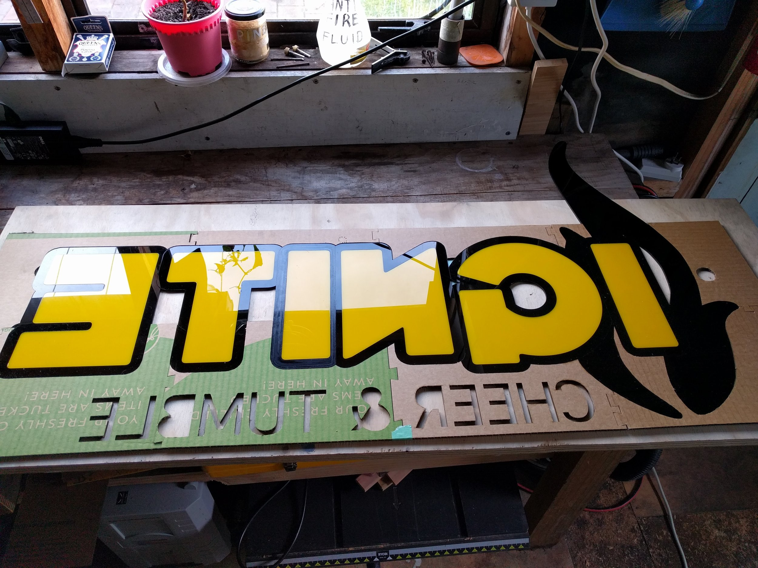 WIP Ignite Cheer & Tumble reception desk signage