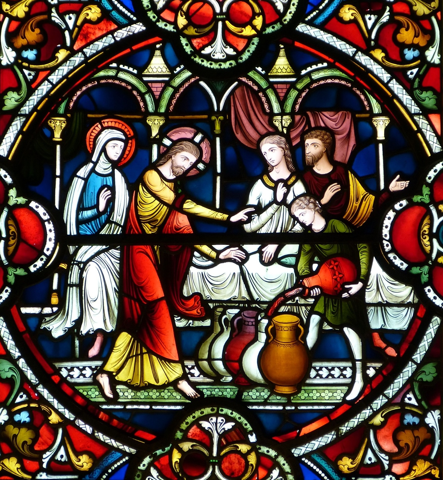 Stained glass window showing miracle at the wedding in Cana
