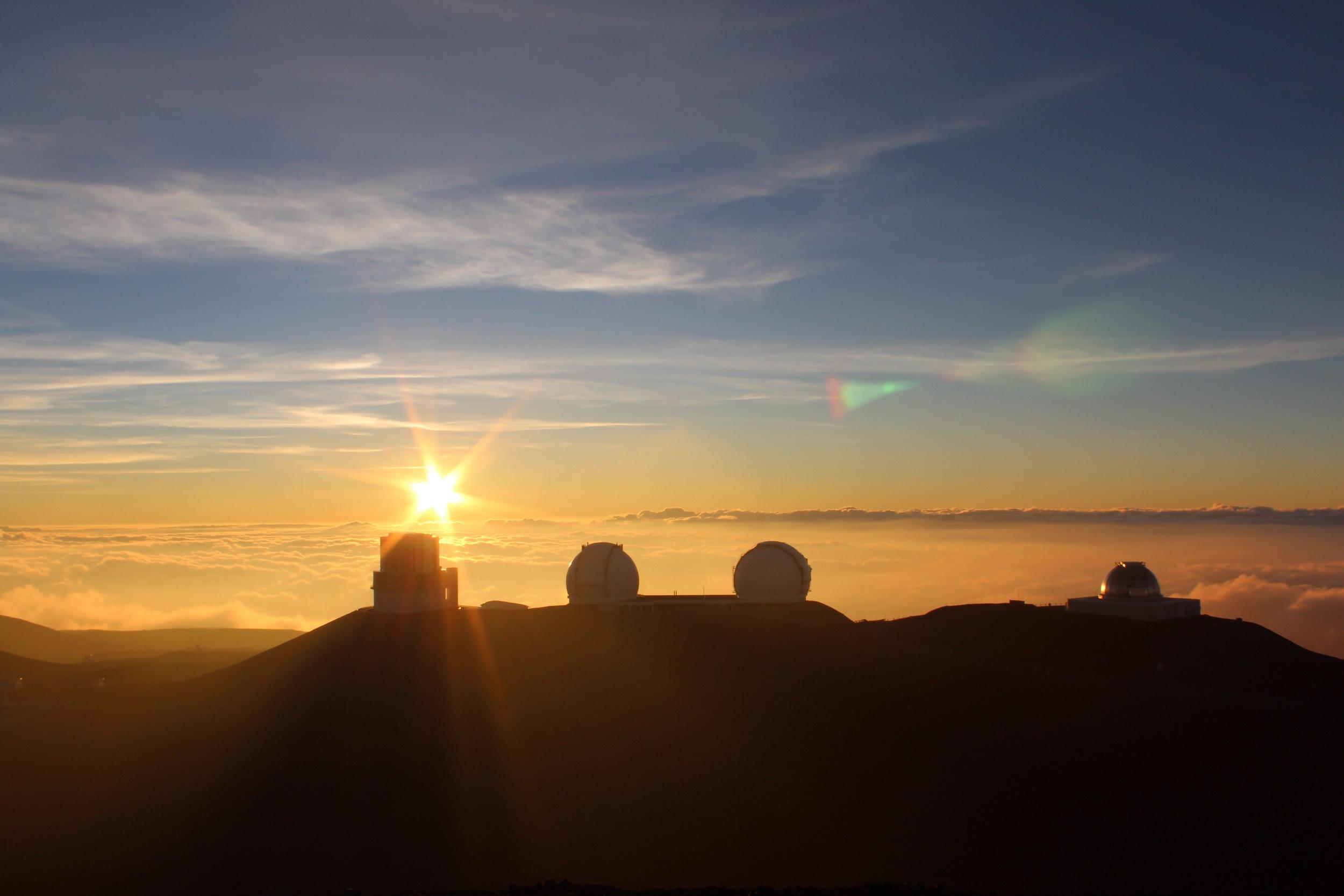 Sun setting past the telescopes