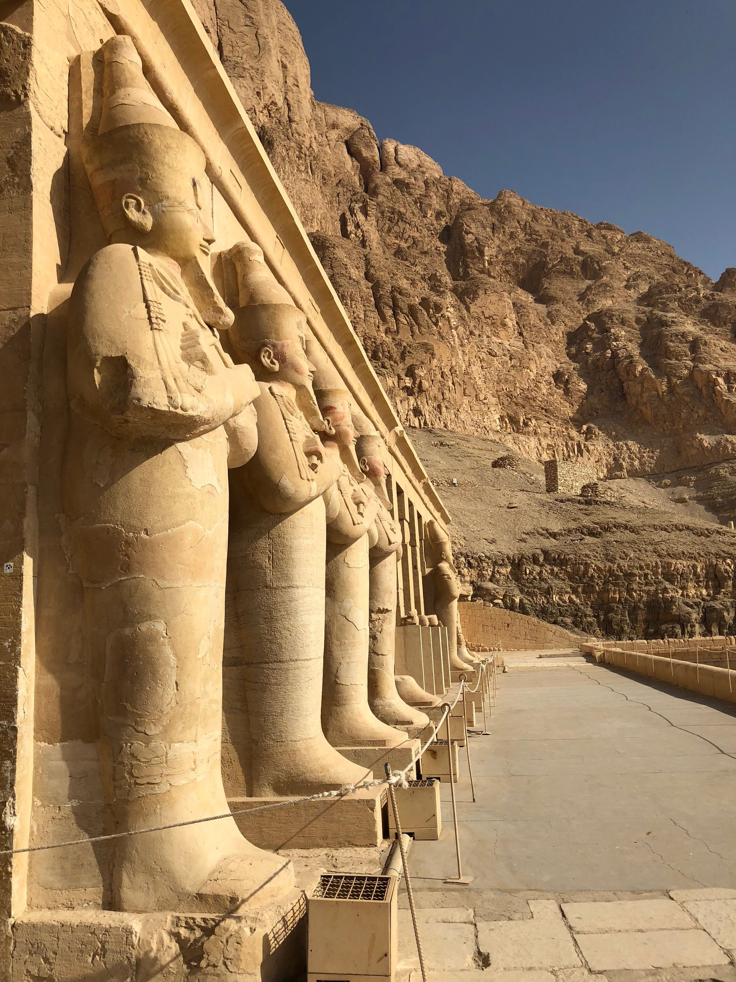 Statues of Hatshepsut atop her temple.
